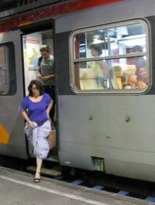 She is getting off the train