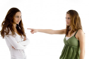 girl pointing at other girl